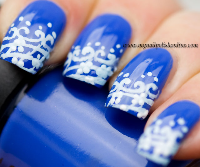 White lace on a sapphire blue background