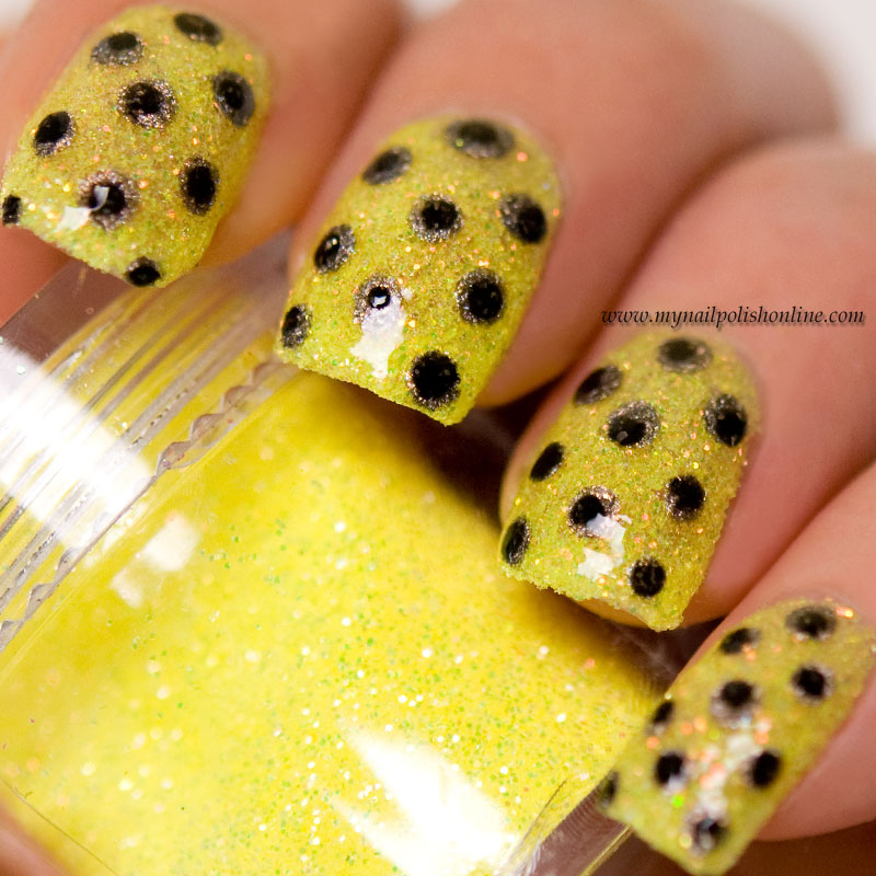 Double dotticure on yellow loose glitter