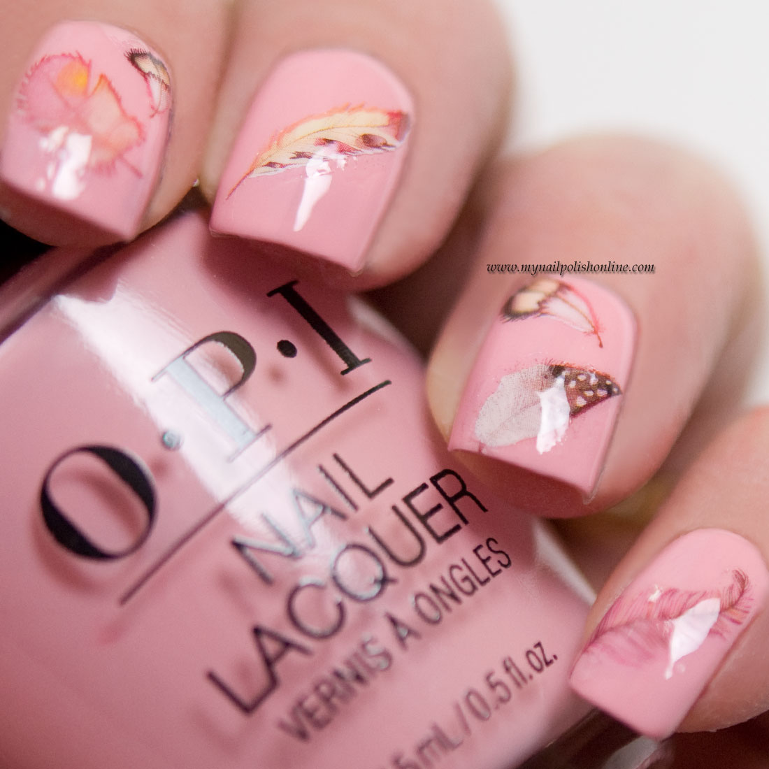 Nail art - feathers on pink